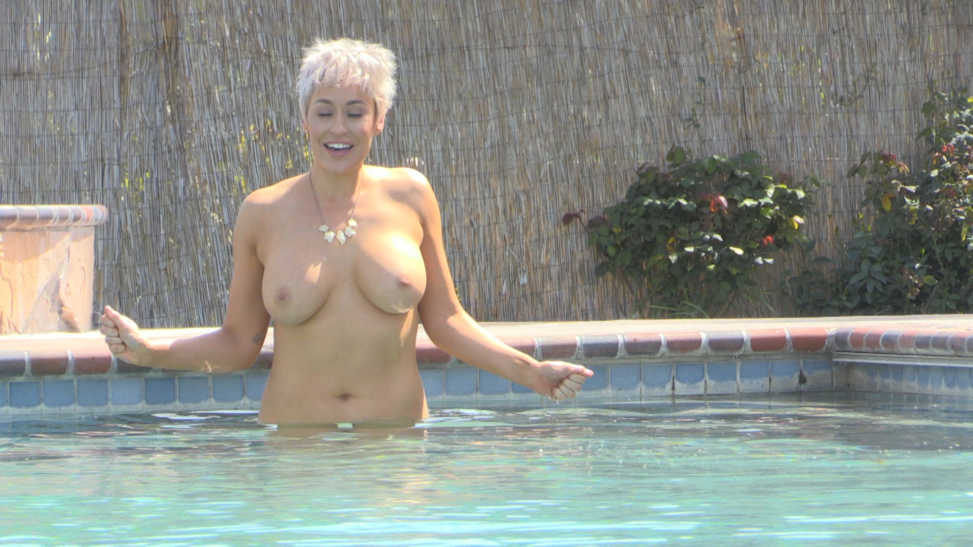 Busty Mature Lady Having Fun in Swimming Pool